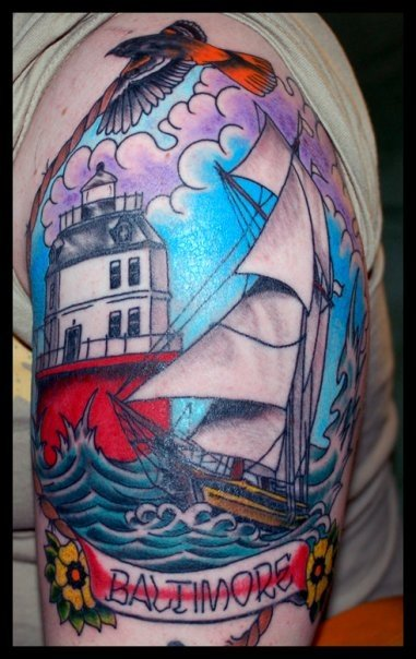 This tattoo of the Baltimore Lighthouse with the Pride of Baltimore sailing